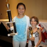 Alice and Pepi with their trophies